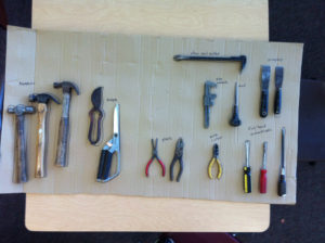 Tools for taking apart. To make sure all tools are returned, I outlined and labeled them. Saw this on a wall at Chimera Makerspace.